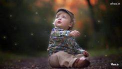 little child sitting on ground
