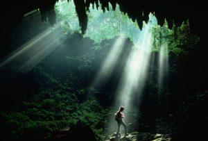 light shining down dark cavern