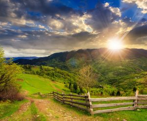 fence in country with sunrise